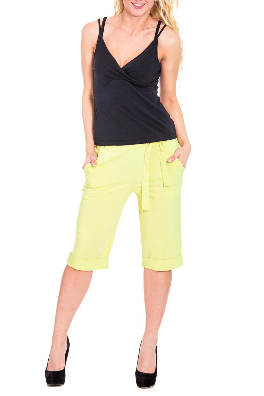 ШортыШорты<br>Яркие летние удлиненные шорты с карманами в боковых швах. Модель выполнена из плотного материала. Отличный выбор для повседневного и делового гардероба.  Цвет: желтый  Рост девушки-фотомодели 170 см<br><br>По материалу: Тканевые<br>По рисунку: Однотонные<br>По сезону: Лето<br>По стилю: Кэжуал,Летний стиль,Молодежный стиль,Повседневный стиль<br>По форме: Брюки-шорты<br>По элементам: С декором,С карманами,С заниженной талией,С резинкой<br>По длине: До колена<br>Размер : 46<br>Материал: Костюмно-плательная ткань<br>Количество в наличии: 1
