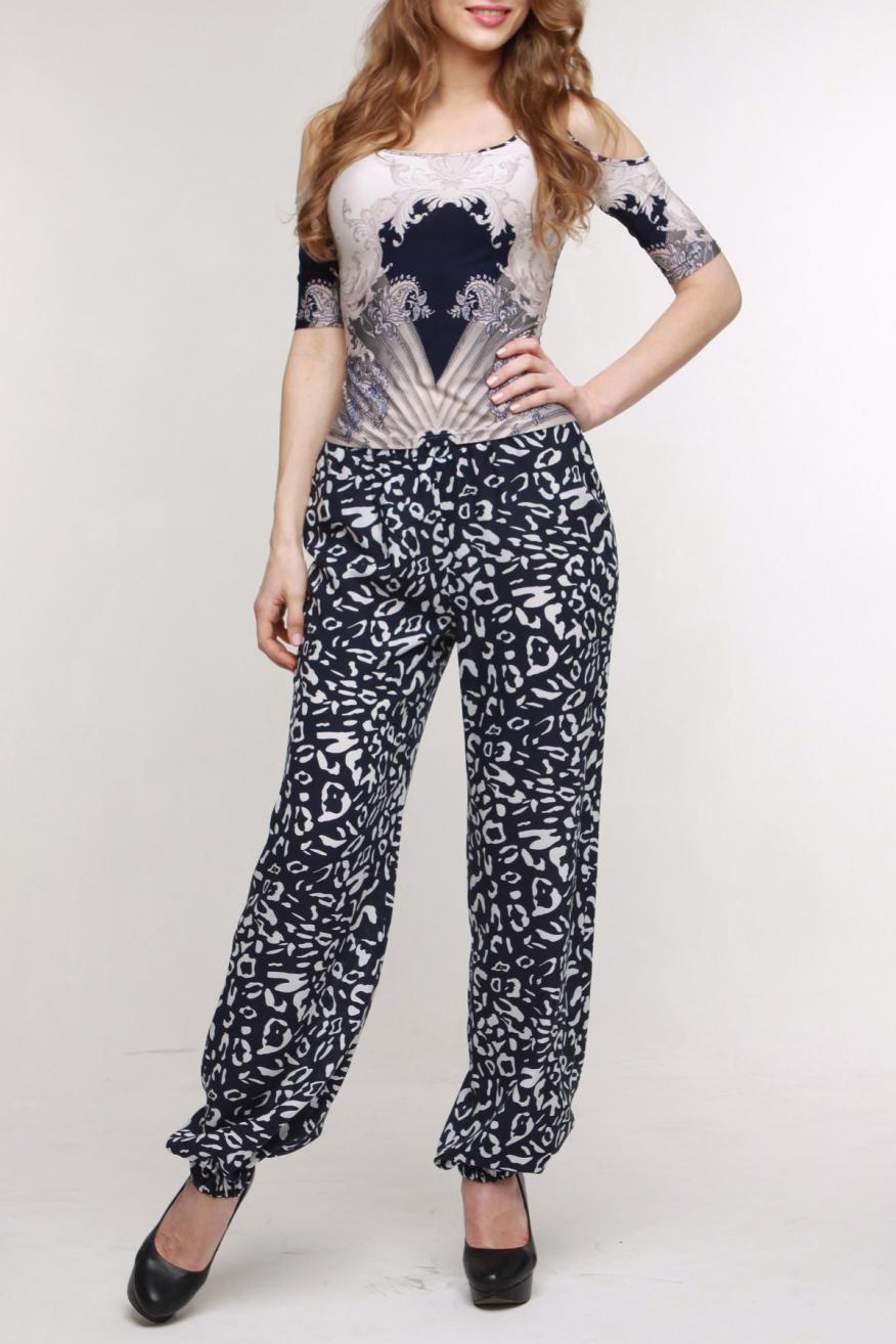 БрюкиБрюки<br>Комфортные летние брюки прямого силуэта из вискозного штапеля. В поясе по линии талии и по низу брюк— широкая резинка.  Цвет: черный, бежевый  Рост девушки-фотомодели 174 см.<br><br>По материалу: Вискоза<br>По рисунку: С принтом,Цветные<br>По силуэту: Свободные<br>По стилю: Повседневный стиль<br>По форме: Шаровары<br>По элементам: С резинкой<br>По сезону: Лето<br>Размер : 48,50,52,56<br>Материал: Вискоза<br>Количество в наличии: 4