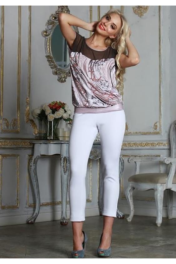 БлузкаБлузки<br>Комбинированная блуза свободного силуэта на поясе. Полочка с фигурной кокеткой из сетки, спинка однотонная, выполнена из легкого трикотажного полотна. Проймы и горловины окантованы.   Длина изделия от 61 см до 65 см, в зависимости от размера.   Стильная модель с полупрозрачной вставкой сделает ваш образ более ярким, женственным, дополнит его нотами сдержанной сексуальности  В изделии использованы цвета: перламутр, черный и др.  Рост девушки-фотомодели 175 см<br><br>Горловина: С- горловина<br>По материалу: Вискоза,Гипюровая сетка<br>По рисунку: С принтом,Цветные<br>По сезону: Весна,Зима,Лето,Осень,Всесезон<br>По силуэту: Свободные<br>По стилю: Повседневный стиль<br>По элементам: С декором<br>Рукав: Короткий рукав<br>Размер : 44<br>Материал: Холодное масло + Гипюровая сетка<br>Количество в наличии: 1