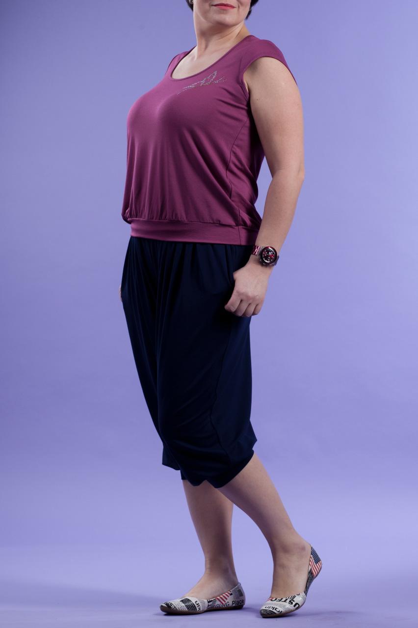 БлузкаБлузки<br>Однотонная женская блузка с короткими рукавами крылышко. Модель выполнена из приятного трикотажа Отличный выбор для повседневного гардероба.  Цвет: фиолетовый  Рост девушки-фотомодели 167 см.<br><br>Горловина: С- горловина<br>По материалу: Вискоза,Трикотаж<br>По рисунку: Однотонные<br>По сезону: Весна,Зима,Лето,Осень,Всесезон<br>По силуэту: Полуприталенные,Свободные<br>По стилю: Повседневный стиль,Летний стиль<br>Рукав: Короткий рукав<br>Размер : 52<br>Материал: Вискоза<br>Количество в наличии: 1