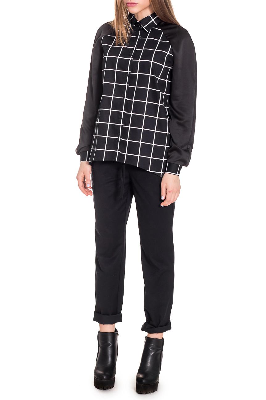 РубашкаРубашки<br>Рубашка - это незаменимый базовый элемент гардероба, который должен быть у каждой женщины. Она легко впишется в любой стиль и внесет особый шарм в Ваш образ.  Рубашка свободного кроя с асимметричным низом. На передней части изделия центральная застежка на пуговицы. На спинке средний шов. Воротник стояче-отложной. Рукав реглан, длинный, с притачной манжетой и застежкой на пуговицу.   Цвет: на черном фоне белые полоски.  Длина рукава (от конечной плечевой точки) - 63 ± 1 см  Рост девушки-фотомодели 168 см  Длина изделия - 74 ± 2 см<br><br>Воротник: Рубашечный,Стояче-отложной<br>Застежка: С пуговицами<br>По материалу: Атлас,Блузочная ткань<br>По рисунку: Цветные,С принтом,В клетку<br>По сезону: Весна,Зима,Лето,Осень,Всесезон<br>По силуэту: Свободные<br>По стилю: Кэжуал,Молодежный стиль,Офисный стиль,Повседневный стиль,Ультрамодный стиль<br>По элементам: С воротником,С декором,С манжетами,С фигурным низом<br>Рукав: Длинный рукав<br>Размер : 42,44,46,48,50,52<br>Материал: Сатин<br>Количество в наличии: 11