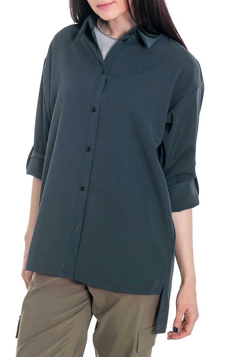 РубашкаРубашки<br>Рубашка - это незаменимый базовый элемент гардероба, который должен быть у каждой женщины. Она легко впишется в любой стиль и внесет особый шарм в Ваш образ.  Рубашка прямого силуэта с карманами в боковых швах. На передней части изделия центральная застежка на планку с пуговицами. На спинке средний шов. Разрезы по боковым швам. Воротник стояче-отложной. Рукав рубашечный, длинный, с притачной манжетой и застежкой на пуговицу, трансформируется в 3/4.  Цвет: серо-зеленый.  Длина рукава (от конечной плечевой точки) - 58 ± 1 см  Рост девушки-фотомодели 169 см  Длина изделия - 77 ± 2 см<br><br>Воротник: Рубашечный,Стояче-отложной<br>Застежка: С пуговицами<br>По материалу: Костюмные ткани,Тканевые<br>По рисунку: Однотонные<br>По сезону: Весна,Зима,Лето,Осень,Всесезон<br>По силуэту: Прямые<br>По стилю: Классический стиль,Кэжуал,Офисный стиль,Повседневный стиль,Ультрамодный стиль<br>По элементам: С воротником,С декором,С карманами,С манжетами,С отделочной фурнитурой,С фигурным низом<br>Рукав: Длинный рукав,Рукав три четверти<br>Размер : 42,44,46,48,50,52<br>Материал: Костюмно-плательная ткань<br>Количество в наличии: 29