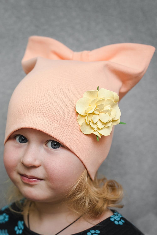 ШапкаГоловные уборы<br>Шапка для девочки защитит Вашего ребенка от непогоды и поднимет настроение.  Размер равен обхвату головы в сантиметрах.  Цвет: персиковый<br><br>По сезону: Осень,Весна<br>Размер : 40-45,45-50,50-55<br>Материал: Трикотаж<br>Количество в наличии: 3