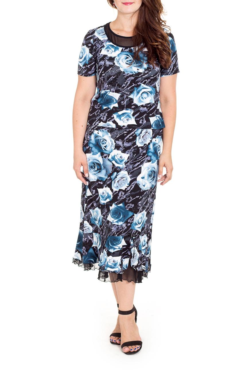 КостюмКостюмы<br>Нарядный костюм состоит из блузки и юбки. Модель выполнена из приятного трикотажа с отделкой из гипюровой сетки. Отличный выбор для любого случая.  В изделии использованы цвета: черный, голубой, белый и др.  Рост девушки-фотомодели 180 см.<br><br>Горловина: С- горловина<br>По длине: Ниже колена<br>По материалу: Трикотаж<br>По образу: Город,Свидание<br>По рисунку: Растительные мотивы,С принтом,Цветные,Цветочные<br>По силуэту: Приталенные<br>По стилю: Нарядный стиль<br>По форме: Костюм двойка,Юбочные<br>По элементам: С воланами и рюшами<br>Рукав: Короткий рукав<br>По сезону: Лето<br>Размер : 56<br>Материал: Трикотаж<br>Количество в наличии: 1