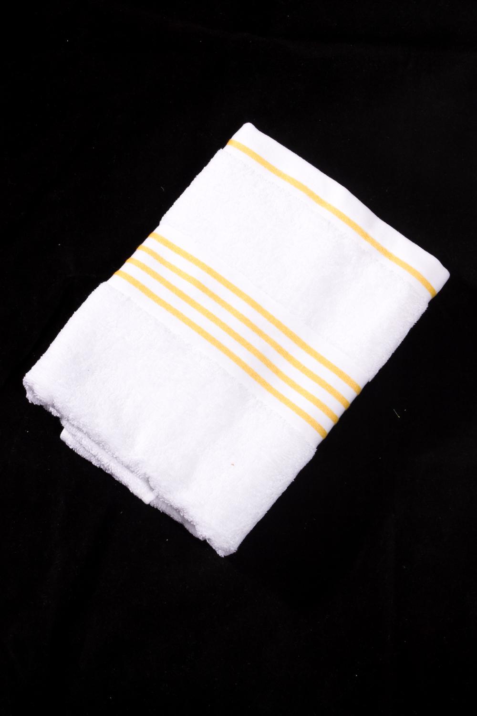 Махровое полотенцеПолотенца<br>Мягкое махровое полотенце  Цвет: белый с желтой полоской<br><br>Отделка края: Отделка строчкой<br>По материалу: Махровые,Хлопок<br>По рисунку: В полоску,Однотонные<br>Размер : 30*50,50*100,70*140<br>Материал: Махровое полотно<br>Количество в наличии: 3