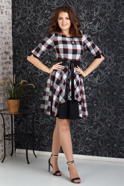 ПлатьеПлатья<br>Эффектное платье в клетку с рукавами до локтя. Модель выполнена из приятного трикотажа. Отличный выбор для повседневного гардероба.Платье без пояса.В изделии использованы цвета: черный, белый, красный и др.Рост девушки-фотомодели 176 см.<br><br>Горловина: С- горловина<br>Рукав: Рукав три четверти<br>Длина: До колена<br>Материал: Трикотаж<br>Рисунок: В клетку,С принтом,Цветные<br>Сезон: Весна,Осень<br>Силуэт: Приталенные<br>Стиль: Повседневный стиль<br>Форма: Платье - трапеция<br>Элементы: С манжетами<br>Размер : 42,46,48<br>Материал: Трикотаж<br>Количество в наличии: 4