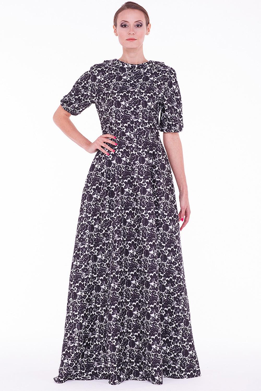 ПлатьеПлатья<br>Женское платье в пол с элегантным вырезом на спине. Модель выполнена из фактурного жаккарда. Отличный выбор для любого случая.  Цвет: черный, белый<br><br>По образу: Город,Свидание,Выход в свет<br>По стилю: Нарядный стиль,Повседневный стиль<br>По материалу: Вискоза,Жаккард<br>По рисунку: Растительные мотивы,Цветные,Цветочные<br>По сезону: Осень,Весна,Всесезон,Зима,Лето<br>По силуэту: Полуприталенные<br>По элементам: С открытой спиной<br>По форме: Платье - футляр<br>По длине: Макси<br>Рукав: До локтя<br>Горловина: Лодочка<br>Размер: 42,44,46<br>Материал: 100% вискоза<br>Количество в наличии: 1