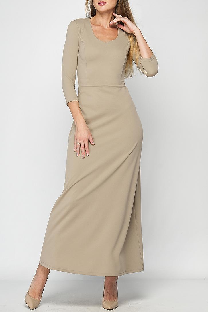 ПлатьеПлатья<br>Женское платье в пол. Модель приталенного силуэта из плотного элластичного трикотажа, имеет фигурный вырез горловины и рукав 3/4. Платье отрезное по линии талии, юбка расклешенная к низу. Это платье отлично дополнит Ваш гардероб, за счет своего простого кроя и однотонного цвета, его можно использовать в огромном количестве образов,как повседневных, так и праздничных, дополняя различными аксессуарами, также оно выгодно подчеркнет все достоинства фигуры.   Параметры изделия:  44 размер: обхват груди - 82 см, обхват талии - 68 см, длина рукава - 46 см, длина изделия - 142 см;  52 размер: обхват груди - 102 см, обхват талии - 90 см, длина рукава - 47 см, длина изделия - 144 см.  В изделии использованы цвета: бежевый  Рост девушки-фотомодели 175 см.<br><br>Горловина: С- горловина<br>По длине: Макси<br>По материалу: Трикотаж<br>По рисунку: Однотонные<br>По силуэту: Полуприталенные<br>По стилю: Кэжуал,Повседневный стиль<br>По форме: Платье - трапеция<br>Рукав: Рукав три четверти<br>По сезону: Осень,Весна<br>Размер : 42,44,46,48,52<br>Материал: Трикотаж<br>Количество в наличии: 5