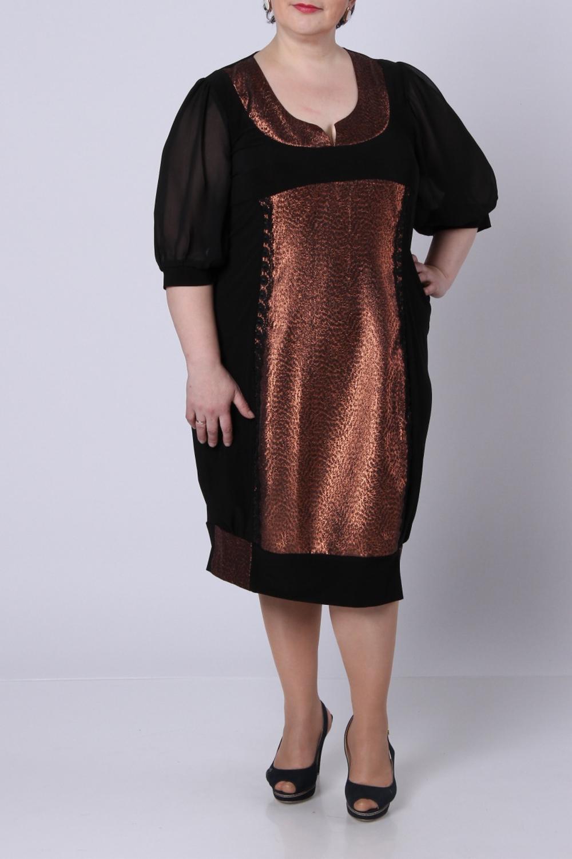 ПлатьеПлатья<br>Нарядное платье из чёрного трикотажа и золотой парчи.  Очень оригинальный фасон, суженый и посаженый на кокетку внизу.  Рукав из шифона: свободный, на манжете. По полочке – вставка из парчи, отделана по краям кружевом. Фигурный вырез по горловине.  Длина по спинке – 105 см.  Спинка черная со швом.  Цвет: черный, бронзовый  Рост девушки-фотомодели 164 см.<br><br>Горловина: С- горловина<br>По длине: Ниже колена<br>По материалу: Вискоза,Трикотаж,Шифон<br>По рисунку: Цветные<br>По сезону: Весна,Всесезон,Зима,Лето,Осень<br>По силуэту: Свободные<br>По стилю: Нарядный стиль<br>Рукав: Рукав три четверти<br>По форме: Платье - баллон<br>По элементам: С манжетами<br>Размер : 58<br>Материал: Холодное масло + Шифон<br>Количество в наличии: 1