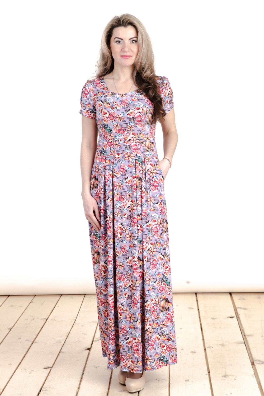 ПлатьеПлатья<br>Цветное платье в пол с круглой горловиной и короткими рукавами. Модель выполнена из приятного трикотажа с цветочным принтом. Отличный выбор для повседневного гардероба.  Цвет: сиреневый, коралловый, бежевый  Длина изделия: 44 размер - 123 см 46 размер - 124 см 48 размер - 125 см 50 размер - 126 см 52 размер - 127 см 54 размер - 128 см 56 размер - 129 см  Длина рукава 17 см.  Рост девушки-фотомодели 163 см<br><br>Горловина: С- горловина<br>По длине: Макси<br>По материалу: Вискоза,Трикотаж<br>По образу: Город,Свидание<br>По рисунку: Растительные мотивы,С принтом,Цветные,Цветочные<br>По силуэту: Полуприталенные<br>По стилю: Повседневный стиль<br>Рукав: Короткий рукав<br>По сезону: Лето<br>Размер : 44,46,48,50,52,54,56<br>Материал: Трикотаж<br>Количество в наличии: 9