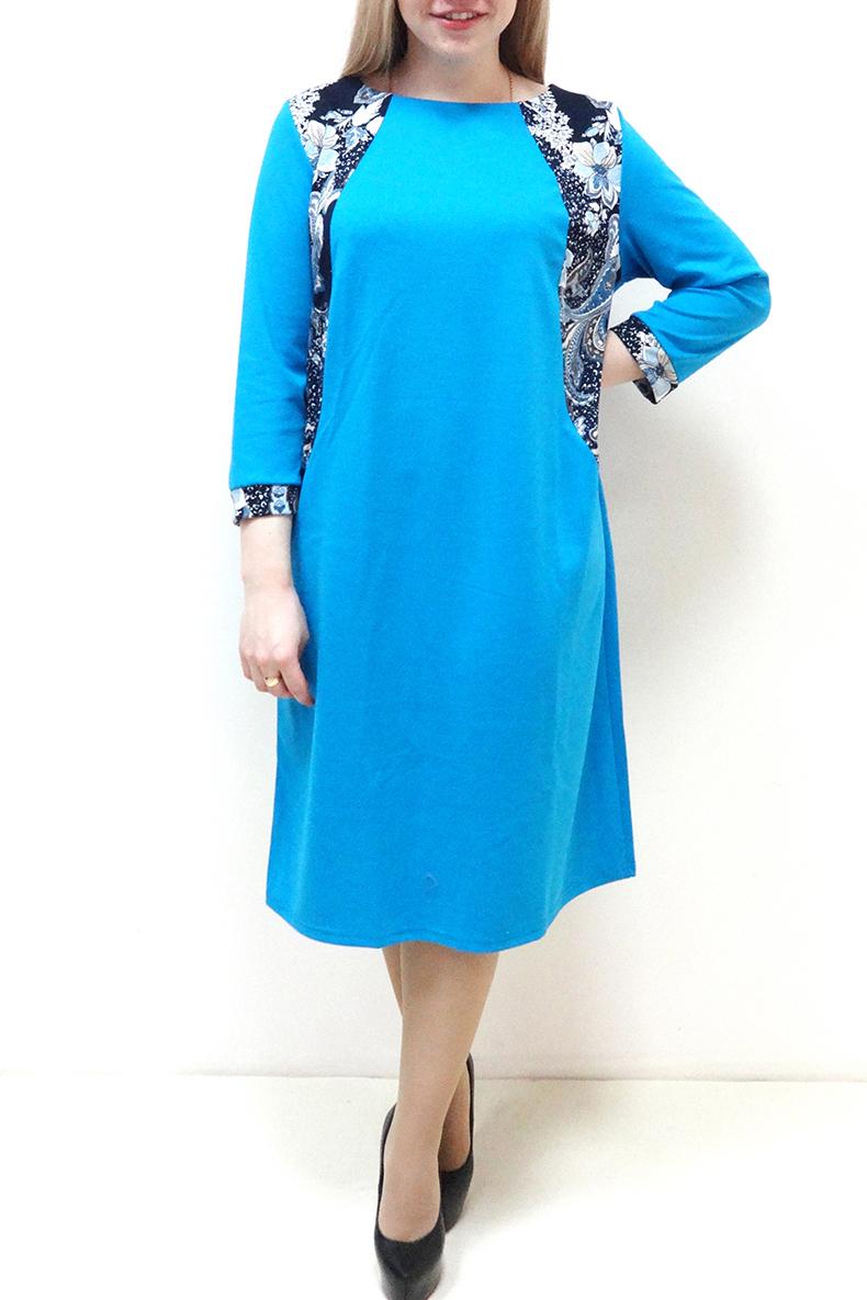 ПлатьеПлатья<br>Красивое платье с круглой горловиной и рукавами 3/4. Модель выполнена из приятного трикотажа. Отличный выбор для повседневного гардероба.  Цвет: голубой, белый, синий  Рост девушки-фотомодели 162 см.<br><br>По длине: Ниже колена<br>По материалу: Вискоза,Трикотаж<br>По рисунку: С принтом,Цветные<br>По силуэту: Полуприталенные<br>По стилю: Повседневный стиль<br>По элементам: С манжетами,С декором<br>Рукав: Рукав три четверти<br>По сезону: Осень,Весна,Зима<br>Горловина: Лодочка<br>Размер : 52,54,56,58,60,62<br>Материал: Джерси<br>Количество в наличии: 11