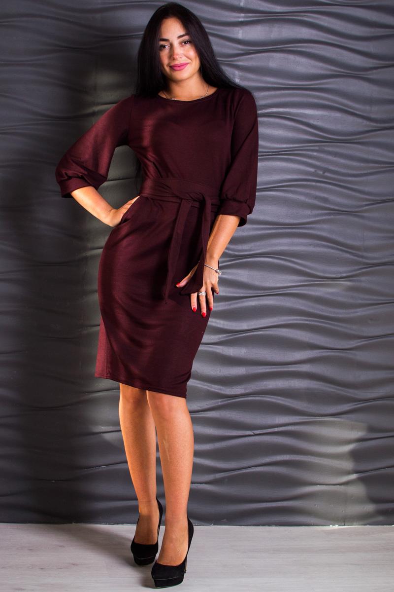 ПлатьеПлатья<br>Модное демисезонное платье до колена с поясом и объемными рукавами. Отлично подойдет как для повседневных прогулок, так и для деловых встреч.   Замеры для изделия 52 размера: Длина по спине — 100 см; Длина рукава — 44 см.  В изделии использованы цвета: бордовый  Ростовка изделия 164 см.  Параметры размеров: 40 размер - обхват груди 80 см., обхват талии 62 см., обхват бедер 86 см. 42 размер - обхват груди 84 см., обхват талии 66 см., обхват бедер 92 см. 44 размер - обхват груди 88 см., обхват талии 70 см., обхват бедер 96 см. 46 размер - обхват груди 92 см., обхват талии 74 см., обхват бедер 100 см. 48 размер - обхват груди 96 см., обхват талии 78 см., обхват бедер 104 см. 50 размер - обхват груди 100 см., обхват талии 82 см., обхват бедер 108 см. 52 размер - обхват груди 104 см., обхват талии 86 см., обхват бедер 112 см. 54 размер - обхват груди 108 см., обхват талии 90 см., обхват бедер 116 см. 56 размер - обхват груди 112 см., обхват талии 94 см., обхват бедер 120 см. 58 размер - обхват груди 116 см., обхват талии 98 см., обхват бедер 124 см. 60 размер - обхват груди 120 см., обхват талии 100 см., обхват бедер 128 см.<br><br>Горловина: С- горловина<br>Длина: Ниже колена<br>Материал: Трикотаж<br>Рисунок: Однотонные<br>Рукав: Рукав три четверти<br>Силуэт: Приталенные<br>Стиль: Классический стиль,Офисный стиль,Повседневный стиль<br>Форма: Платье - футляр<br>Элементы: С манжетами,С поясом<br>Сезон: Осень,Весна<br>Размер : 44,46,48<br>Материал: Трикотаж<br>Количество в наличии: 3
