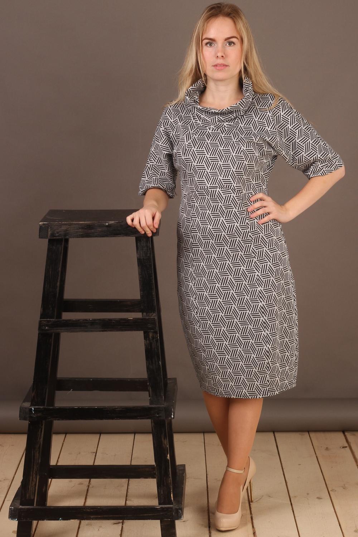 ПлатьеПлатья<br>Красивое платье с объемным воротником и рукавами 3/4. Модель выполнена из плотного трикотажа. Отличный выбор для повседневного гардероба.  В изделии использованы цвета: серый, черный  Длина изделия: 48 размер - 103 см 50 размер - 104 см 52 размер - 105 см 54 размер - 106 см 56 размер - 107 см 58 размер - 108 см  Рост девушки-фотомодели 161 см.<br><br>Воротник: Хомут<br>По длине: До колена<br>По материалу: Вискоза,Трикотаж<br>По рисунку: С принтом,Цветные<br>По силуэту: Полуприталенные<br>По стилю: Повседневный стиль<br>По форме: Платье - футляр<br>По элементам: С разрезом<br>Разрез: Короткий<br>Рукав: Рукав три четверти<br>По сезону: Осень,Весна,Зима<br>Размер : 50,52,54,56,58<br>Материал: Джерси<br>Количество в наличии: 6