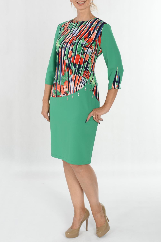 ПлатьеПлатья<br>Модель-женственность Линии кроя своими изгибами определяют всю красоту женской фигуры, а отделка маленькими скрипичными ключами только подчеркивает изысканность модели.  Ткань комбинированная. Однотонная плательная ткань со стрейчем (не толстая) и цветной трикотаж по переду и вставкам рукавов.  В изделии использованы цвета: зеленый, красный, синий и др.  Ростовка изделия 170 см.<br><br>Горловина: С- горловина<br>По длине: Ниже колена<br>По материалу: Трикотаж<br>По рисунку: Растительные мотивы,С принтом,Цветные,Цветочные<br>По силуэту: Полуприталенные<br>По стилю: Повседневный стиль<br>По форме: Платье - футляр<br>По элементам: С декором,С отделочной фурнитурой<br>Рукав: Рукав три четверти<br>По сезону: Осень,Весна<br>Размер : 50<br>Материал: Трикотаж<br>Количество в наличии: 1