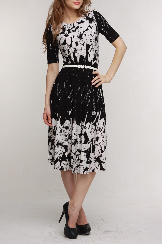 ПлатьеПлатья<br>Женское платье с круглой горловиной и рукавами до локтя. Модель выполнена из приятного материала. Отличный выбор для повседневного гардероба. Платье с поясом.  В изделии использованы цвета: черный, белый  Рост девушки-фотомодели 176 см<br><br>Горловина: С- горловина<br>По длине: Ниже колена<br>По материалу: Трикотаж<br>По рисунку: Растительные мотивы,С принтом,Цветные,Цветочные<br>По силуэту: Приталенные<br>По стилю: Повседневный стиль<br>По форме: Платье - трапеция<br>По элементам: С поясом<br>Рукав: До локтя<br>По сезону: Осень,Весна<br>Размер : 50,52<br>Материал: Холодное масло<br>Количество в наличии: 4