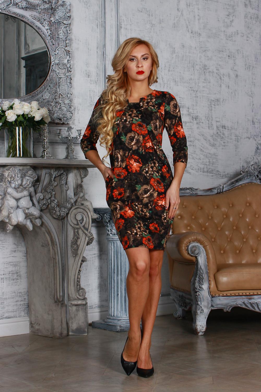 ПлатьеПлатья<br>Элегантное платье из полушерстяного трикотажного полотна, полуприлегающего силуэта с узким втачным рукавом 3/4. От  центра горловины заложены 2 направленные складки, расходящиеся лучами к боковым швам. Платье с внутренними боковыми карманами.  Длина изделия от 92 см до 98 см , в зависимости от размера.  Цвет: черный, оранжевый, бежевый, зеленый  Рост девушки-фотомодели 175 см<br><br>По длине: До колена<br>По материалу: Трикотаж,Шерсть<br>По рисунку: Растительные мотивы,С принтом,Цветные,Цветочные<br>По сезону: Весна,Зима,Осень<br>По силуэту: Полуприталенные<br>По стилю: Повседневный стиль<br>По форме: Платье - футляр<br>По элементам: С декором,Со складками<br>Рукав: Рукав три четверти<br>Горловина: Фигурная горловина<br>Размер : 48<br>Материал: Трикотаж<br>Количество в наличии: 1