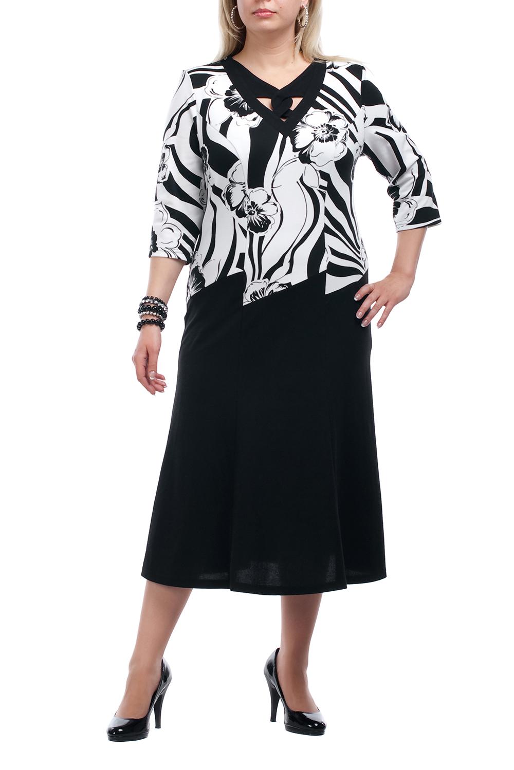 ПлатьеПлатья<br>Повседневное платье с фигурной горловиной и рукавами 3/4. Модель выполнена из плотного трикотажа. Отличный выбор для повседневного гардероба.  Цвет: черный, белый  Рост девушки-фотомодели 173 см.<br><br>По длине: Ниже колена<br>По материалу: Вискоза,Трикотаж<br>По рисунку: Растительные мотивы,Цветные<br>По силуэту: Полуприталенные<br>По стилю: Повседневный стиль<br>По форме: Платье - футляр<br>Рукав: Рукав три четверти<br>По сезону: Осень,Весна,Зима<br>Горловина: Фигурная горловина<br>Размер : 52,54<br>Материал: Трикотаж<br>Количество в наличии: 6