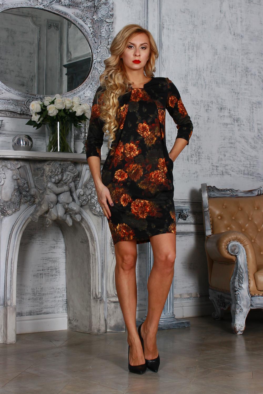 ПлатьеПлатья<br>Элегантное платье из полушерстяного трикотажного полотна, полуприлегающего силуэта с узким втачным рукавом 3/4. От  центра горловины заложены 2 направленные складки, расходящиеся лучами к боковым швам. Платье с внутренними боковыми карманами.  Длина изделия от 92 см до 98 см , в зависимости от размера.  Цвет: черный, оранжевый, бежевый, зеленый  Рост девушки-фотомодели 175 см<br><br>По длине: До колена<br>По материалу: Трикотаж,Шерсть<br>По рисунку: Растительные мотивы,С принтом,Цветные,Цветочные<br>По сезону: Весна,Зима,Осень<br>По силуэту: Полуприталенные<br>По стилю: Повседневный стиль<br>По форме: Платье - футляр<br>По элементам: Со складками,С карманами<br>Рукав: Рукав три четверти<br>Горловина: Фигурная горловина<br>Размер : 46,50<br>Материал: Трикотаж<br>Количество в наличии: 2
