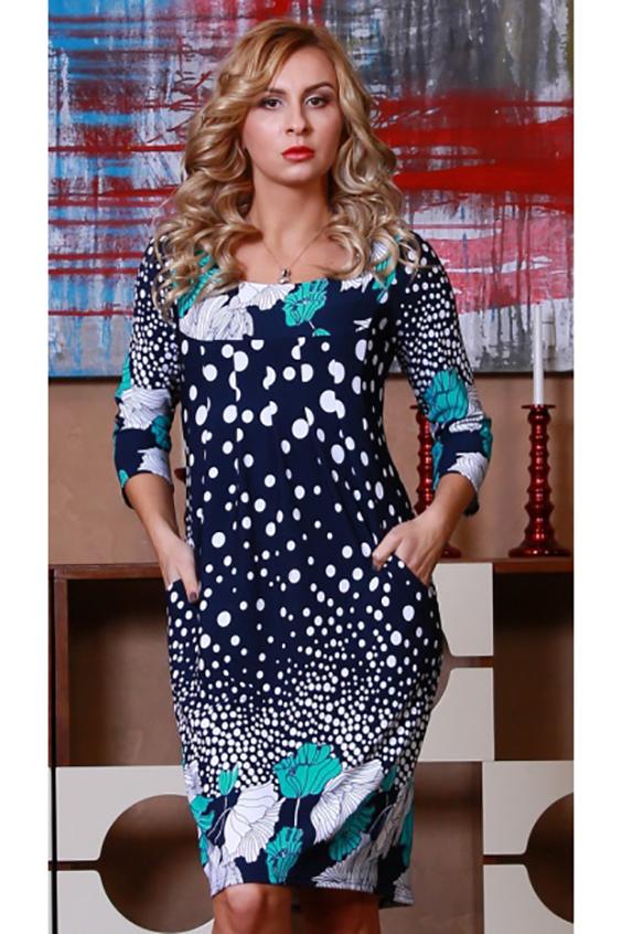 ПлатьеПлатья<br>Платье из плотного трикотажного полотна с рельефным рисунком  свободного кроя с внутренними боковыми карманами, округлым вырезом горловины и рукавом 3/4.  Декоративные складки под грудью удачно смягчают силуэт.  Длина изделия от 97 см до 103 см, в зависимости от размера.  Цвет: синий, белый, бирюзовый  Рост девушки-фотомодели 175 см<br><br>Горловина: С- горловина<br>По длине: До колена<br>По материалу: Вискоза,Трикотаж<br>По образу: Город,Свидание<br>По рисунку: В горошек,Растительные мотивы,С принтом,Цветные,Цветочные<br>По силуэту: Приталенные<br>По стилю: Повседневный стиль<br>По форме: Платье - футляр<br>Рукав: Рукав три четверти<br>По сезону: Осень,Весна<br>Размер : 46,48<br>Материал: Трикотаж<br>Количество в наличии: 2