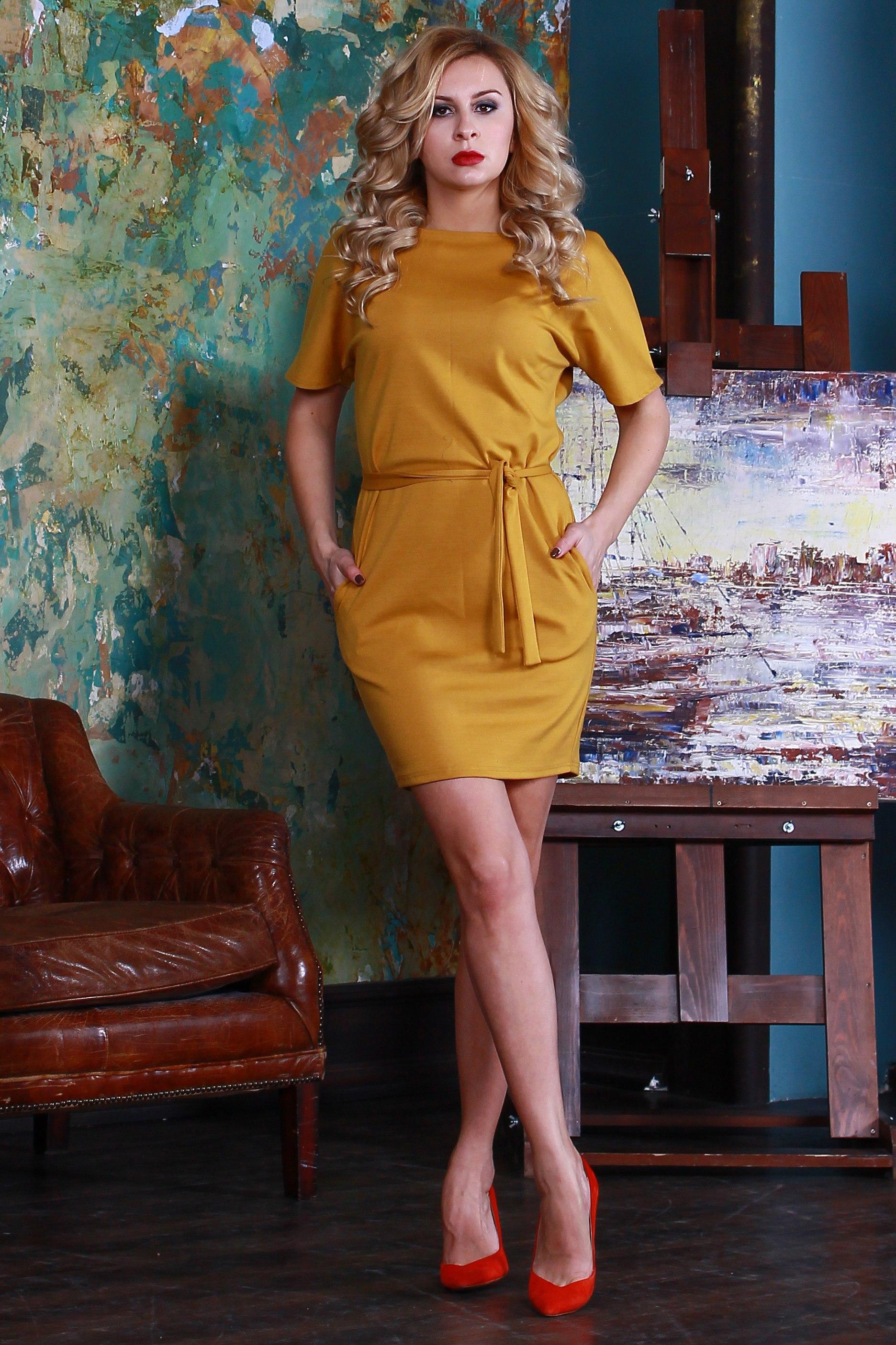 ПлатьеПлатья<br>Платье из плотного джерси прилегающего силуэта, со спущенной линией плеча и внутренними боковыми карманами, вырез - quot;лодочкаquot;.  Платье без пояса.  Длина изделия от 87 см до 93 см, в зависимости от размера.  Цвет: горчичный  Рост девушки-фотомодели 175 см<br><br>Горловина: С- горловина<br>По длине: До колена<br>По материалу: Трикотаж<br>По рисунку: Однотонные<br>По силуэту: Полуприталенные<br>По стилю: Повседневный стиль<br>По форме: Платье - футляр<br>Рукав: До локтя<br>По сезону: Осень,Весна,Зима<br>По элементам: С карманами<br>Размер : 42,44,50,54<br>Материал: Трикотаж<br>Количество в наличии: 5
