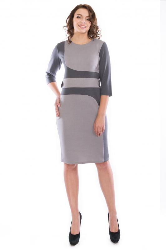 ПлатьеПлатья<br>Повседневное и в тоже время элегантное платье-футляр.  Контрастные вставки спереди платья подчеркивают элегантность силуэта. Пояс платья декорирован двумя хлястиками, которые закреплены с пуговицами. Рукава 3/4 цвета вставок Вырез горловины лодочка.  Длина изделия 102-104 см.   Ткань - плотный трикотаж, характеризующийся эластичностью, растяжимостью и мягкостью.   Цвет: серый  Рост девушки-фотомодели 173 см<br><br>По образу: Офис,Свидание,Город<br>По стилю: Офисный стиль,Повседневный стиль<br>По материалу: Вискоза,Трикотаж<br>По рисунку: Цветные<br>По сезону: Зима<br>По силуэту: Полуприталенные<br>По элементам: С декором<br>По форме: Платье - футляр<br>По длине: Ниже колена<br>Рукав: Рукав три четверти<br>Горловина: С- горловина<br>Размер: 46,48,50,52<br>Материал: 78% вискоза 19% полиэстер 3% эластан<br>Количество в наличии: 5