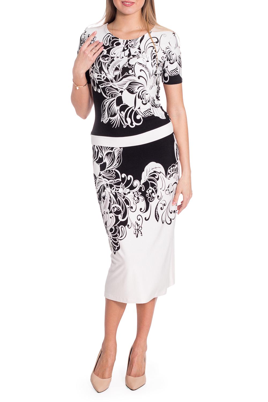ПлатьеПлатья<br>Цветное платье длиной quot;мидиquot; приталенного силуэта с круглой горловиной и короткими рукавами. Модель выполнена из приятного материала. Отличный выбор для повседневного гардероба. Ростовка изделия 164 см.  В изделии использованы цвета: белый, черный  Рост девушки-фотомодели 180 см  Параметры размеров: 42 размер - обхват груди 84 см., обхват талии 66 см., обхват бедер 90 см. 44 размер - обхват груди 88 см., обхват талии 70 см., обхват бедер 94 см. 46 размер - обхват груди 92 см., обхват талии 74 см., обхват бедер 98 см. 48 размер - обхват груди 96 см., обхват талии 78 см., обхват бедер 102 см. 50 размер - обхват груди 100 см., обхват талии 82 см., обхват бедер 106 см. 52 размер - обхват груди 104 см., обхват талии 86 см., обхват бедер 110 см. 54 размер - обхват груди 108 см., обхват талии 92 см., обхват бедер 116 см. 56 размер - обхват груди 112 см., обхват талии 98 см., обхват бедер 122 см. 58 размер - обхват груди 116 см., обхват талии 104 см., обхват бедер 128 см. 60 размер - обхват груди 120 см., обхват талии 110 см., обхват бедер 134 см. 62 размер - обхват груди 124 см., обхват талии 118 см., обхват бедер 140 см. 64 размер - обхват груди 128 см., обхват талии 126 см., обхват бедер 146 см. 66 размер - обхват груди 132 см., обхват талии 132 см., обхват бедер 152 см. 68 размер - обхват груди 138 см., обхват талии 140 см., обхват бедер 158 см.<br><br>Горловина: С- горловина<br>По длине: Ниже колена<br>По материалу: Вискоза<br>По рисунку: С принтом,Цветные<br>По сезону: Весна,Лето<br>По силуэту: Приталенные<br>По стилю: Повседневный стиль<br>По форме: Платье - футляр<br>Рукав: Короткий рукав<br>Размер : 52<br>Материал: Вискоза<br>Количество в наличии: 1