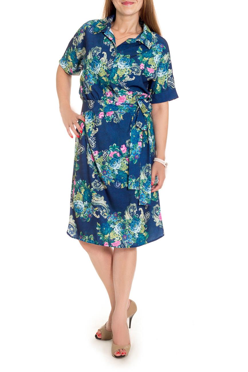 ПлатьеПлатья<br>Классика и элегантность - это залог успеха для создания Вашего повседневного образа. Дополните это стильное платье модными аксессуарами и завершите образ успешной женщины  Платье свободного кроя, отрезное по линии талии с резинкой. На передней части лифа центральная застежка на пуговицы. На спинке средний шов. Низ изделия фигурный. Воротник quot;отложнойquot;. Рукав цельнокроенный, с притачной манжетой, до локтя.  Цвет: синий, голубой и др.  Длина рукава (от конечной плечевой точки) - 23 ± 1 см  Рост девушки-фотомодели 174 см  Длина изделия - 112 ± 2 см<br><br>Воротник: Рубашечный,Стояче-отложной<br>По длине: Ниже колена<br>По материалу: Вискоза,Тканевые<br>По рисунку: С принтом,Цветные,Растительные мотивы,Цветочные<br>По сезону: Лето,Осень,Весна<br>По силуэту: Свободные<br>По стилю: Повседневный стиль<br>По форме: Платье - рубашка<br>По элементам: С воротником,С декором,С манжетами,С поясом,С пуговицами<br>Рукав: До локтя<br>Размер : 50<br>Материал: Плательно-блузочная ткань<br>Количество в наличии: 1