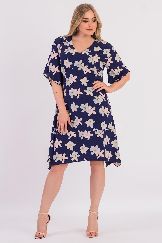 ПлатьеПлатья<br>Эксклюзивное платье из приятного к телу материала. Эта модель выглядит очень женственно и неординарно.  Платье полуприлегающего силуэта с широким фигурным воланом по низу. На передней части изделия фигурный рез под грудью со сборкой. На спинке средний шов. Горловина обработана обтачкой. Рукав рубашечный, до локтя, со спущенной линией плеча и фигурным низом.  В изделии использованы цвета: синий, голубой, розовый.  Длина рукава (от конечной плечевой точки) - 30 ± 1 см  Рост девушки-фотомодели 170 см  Длина изделия: 46 размер - 109 ± 2 см 48 размер - 109 ± 2 см 50 размер - 109 ± 2 см 52 размер - 109 ± 2 см 54 размер - 111 ± 2 см 56 размер - 111 ± 2 см 58 размер - 111 ± 2 см<br><br>Горловина: V- горловина<br>По длине: Ниже колена<br>По материалу: Тканевые<br>По рисунку: Растительные мотивы,С принтом,Цветные,Цветочные<br>По стилю: Повседневный стиль,Романтический стиль<br>По форме: Платье - трапеция<br>По элементам: С вырезом,С фигурным низом<br>Рукав: До локтя<br>По сезону: Осень,Весна<br>Размер : 48,50,52,54,56,58<br>Материал: Плательная ткань<br>Количество в наличии: 29