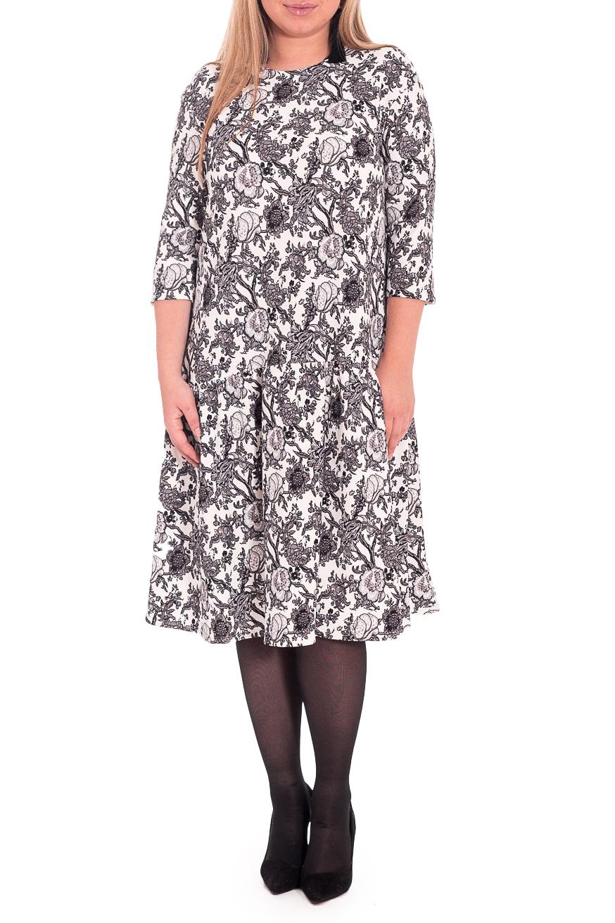 ПлатьеПлатья<br>Элегантное и женственное платье, которое подойдет любому типу фигуры, выполненное из приятного телу трикотажа.  Платье силуэта quot;трапецияquot; с широким асимметричным воланом со сборкой по низу изделия. На спинке средний шов. Горловина круглая. Рукав рубашечный, 3/4, со спущенной линией плеча.  В изделии использованы цвета: белый, коричнево-бежевый.  Длина рукава (от конечной плечевой точки) - 42 ± 1 см  Рост девушки-фотомодели 170 см  Длина изделия: 46 размер - 101 ± 2 см 48 размер - 101 ± 2 см 50 размер - 101 ± 2 см 52 размер - 101 ± 2 см 54 размер - 104 ± 2 см 56 размер - 104 ± 2 см 58 размер - 104 ± 2 см<br><br>Горловина: С- горловина<br>По длине: Ниже колена<br>По материалу: Трикотаж<br>По рисунку: Растительные мотивы,С принтом,Цветные,Цветочные<br>По стилю: Повседневный стиль<br>По форме: Платье - трапеция<br>По элементам: С фигурным низом,Со складками<br>Рукав: Рукав три четверти<br>По сезону: Осень,Весна<br>Размер : 52,54,56,58<br>Материал: Трикотаж<br>Количество в наличии: 30