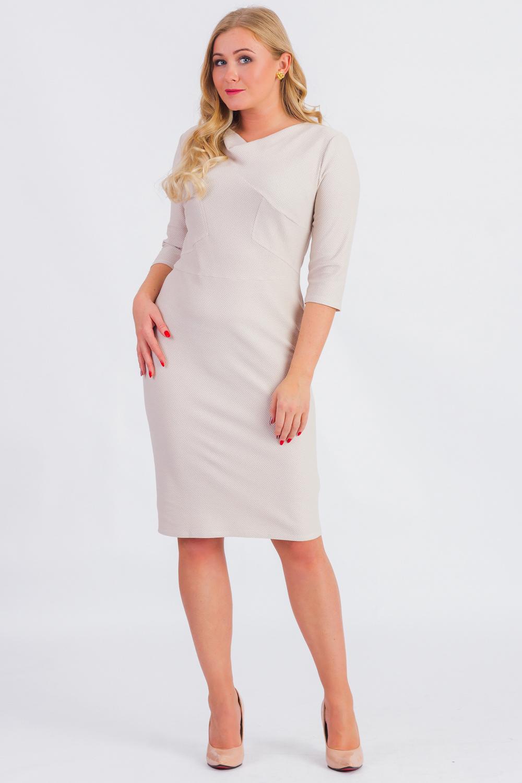 ПлатьеПлатья<br>Классическое женское платье - это универсальный предмет одежды, в котором можно пойти как на работу, так и на свидание.  Платье приталенного силуэта, отрезное по линии талии. На передней части кокетка и резы с отделочными строчками. На спинке средний шов и шлица. Горловина качелька. Рукав втачной, 3/4.  Цвет: бежевый.  Длина рукава - 44 ± 1 см  Рост девушки-фотомодели 173 см  Длина изделия: 44 размер - 102 ± 2 см 46 размер - 102 ± 2 см 48 размер - 102 ± 2 см 50 размер - 102 ± 2 см 52 размер - 105 ± 2 см 54 размер - 105 ± 2 см 56 размер - 105 ± 2 см<br><br>Горловина: Качель<br>По длине: Ниже колена<br>По материалу: Трикотаж<br>По рисунку: Однотонные<br>По силуэту: Приталенные<br>По стилю: Классический стиль,Кэжуал,Офисный стиль,Повседневный стиль<br>По форме: Платье - футляр<br>По элементам: С разрезом<br>Разрез: Шлица<br>Рукав: Рукав три четверти<br>По сезону: Осень,Весна<br>Размер : 46,48,50,52,54,56<br>Материал: Трикотаж<br>Количество в наличии: 28