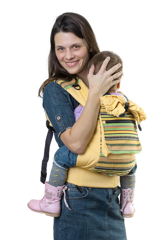 Слинг-рюкзакСлинги, кенгуру и эрго-рюкзаки<br>Мы выбрали самую жизнерадостную и стильную ткань, какую только смогли найти. Рюкзак несёт дух свободы и позитива. С ним и мама, и малыш будут чувствовать себя уверенно и комфортно. Уичоли - классический слинг-рюкзак в этно-стиле.  Уичоли – это племя индейцев, которые носят множество вышитых сумочек и вообще любят слинги, сумки, такачество и вышивку. За это антропологи назвали Уичолей «племенем художников».  Стильный дизайн Мы выбрали самую жизнерадостную и стильную ткань, какую только смогли найти. Рюкзак несёт дух свободы и позитива. С ним и мама, и малыш будут чувствовать себя уверенно и комфортно. Уичоли - классический слинг-рюкзак в этно-стиле. 6 расцветок на любой вкус Спокойные и яркие, для папы и для мамы, к разным нарядам – каждый может выбрать слинг-рюкзак себе по вкусу. 100% хлопок твил Натуральные ткани традиционно используют для детских изделий. Дышащий, гипоаллергенный, износостойкий и простой в уходе твил отлично подходит для слинг-рюкзака «Уичоли». Мягкий твил внутри рюкзака не натрет нежную кожу малыша. Улучшенный крой Мы думаем о свободолюбивых малышах и внесли небольшие изменения в крой, теперь рюкзак меньше стесняет ручки ребёнка. Продуманная конструкция По верхнему краю рюкзака сделан мягкий валик, что бы спинке малыша было комфортно. Мягкие края сиденья не врезаются в ножки, около лямок так же проложен синтепон для мягкости. Широкий пояс помогает правильно распределить вес и разгружает спину. Все крепления лямок и края сиденья дополнительно усилены. Продуманные детали: есть карман для мелочей и капюшон. Прочные лямки В лямках рюкзака в качестве наполнителя использована специальная пенка. Она хорошо держит форму, устойчива к самой интенсивной эксплуатации и не подвержена разрушению под воздействием воды, моющих средств и ультрафиолетовых лучей. Дополнительный аксессуар – рюкзак  в цвет Вечная проблема, куда положить кошелёк, телефон и ключи теперь решена. Приобретите вместе со слинг-рюкзаком сумку для