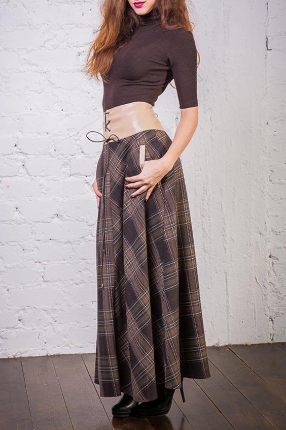ЮбкаДлинная расклешённая юбка из костюмной ткани, на подкладе из трикотажного вискозного полотна. Пояс-корсет юбки выполнен из эко-кожи. Тёплая, комфортная юбка. Застёжка на потайную молнию и кожаный шнур. Юбка декорирована функциональными карманами.  Цвет: коричневый, бежевый  Ростовка изделия 170 см.<br><br>По длине: Макси<br>По материалу: Вискоза,Кожа,Тканевые<br>По образу: Город,Офис,Свидание<br>По рисунку: С принтом,Цветные,В клетку<br>По силуэту: Свободные<br>По стилю: Повседневный стиль<br>По элементам: С декором<br>По сезону: Осень,Весна<br>Размер : 46<br>Материал: Костюмная ткань + Искусственная кожа<br>Количество в наличии: 1